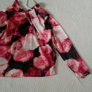 Pink and black floral long sleeve blouse.